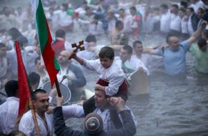 bulgarian boy with cross in cold water